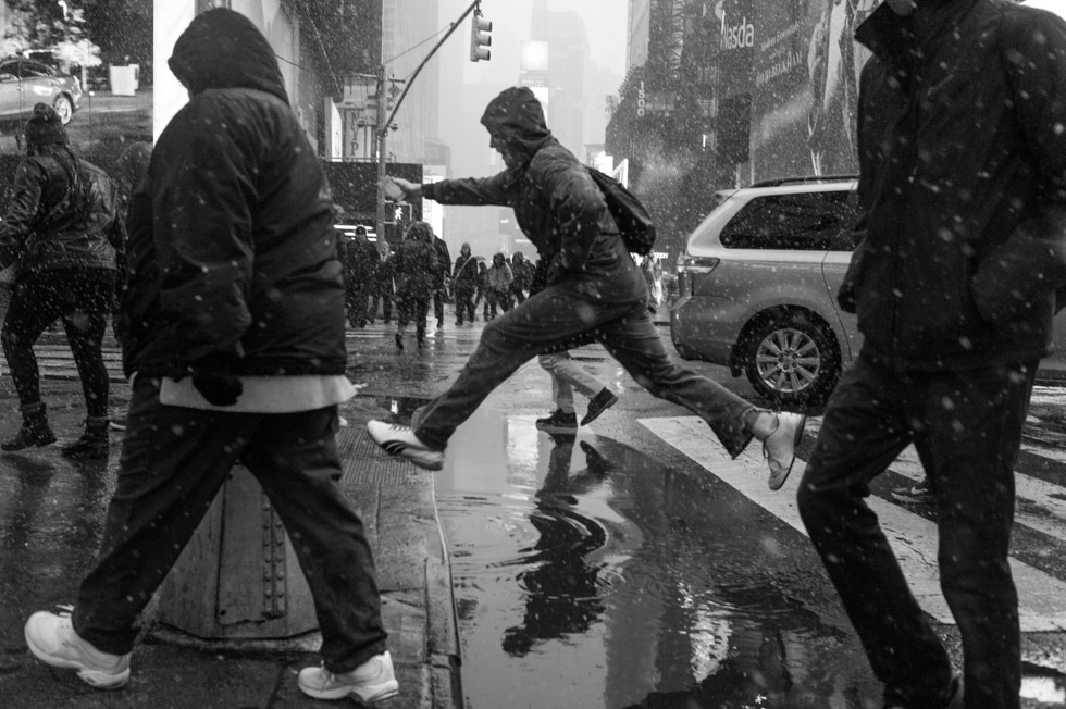 New York jumping over puddle photograph. 42nd Street & Broadway at Times Square, New York City, 2015.