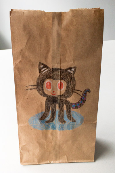 An octocat on a paper bag, colored pencil on brown paper bag.